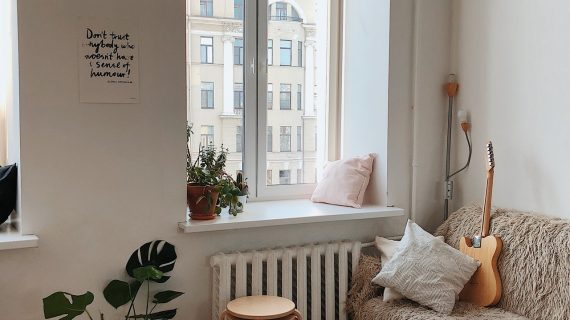 a picture of a small living room with few decors